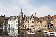 Belgium, Bruges, boat with tourists driving on Rozenhoedkaai - GW003785