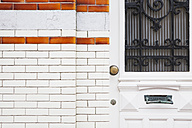 Belgium, Flanders, Blankenberge, entry door of an old house with tiled facade - GWF004481
