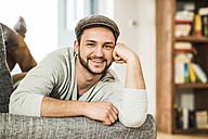 Portrait of smiling young man at home - UUF003353
