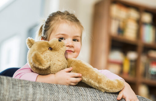 Portrait of smiling girl with teddy - UUF003356