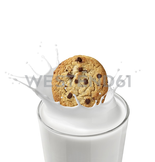 Chocolate cookie falling in glass of milk in front of white background - RAMF000043