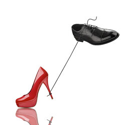 Black man's shoe and red high heel in front of white background - RAMF000053