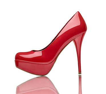 Red high heel in front of white background - RAMF000054