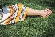 Woman lying on a meadow, partial view - DEGF000121