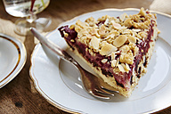 Chocolate chip cherry cake with an almond streusel topping on plate - HAWF000635