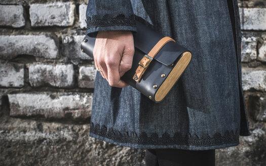 Woman's hand holding leather handbag - DEGF000338