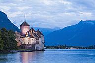 Switzerland, Veytaux, Lake Geneva, Chillon Castle at dusk - WDF002874