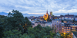 Switzerland, Lausanne, cityscape with cathedral Notre-Dame at dusk - WDF002904