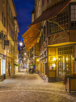 Switzerland, Vevey, Rue du Lac, restaurants and shops at night - WD002940