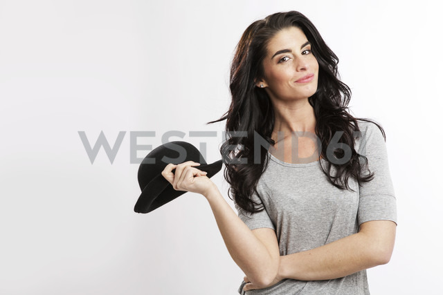 Portrait of smiling young woman with bowler hat - GDF000691