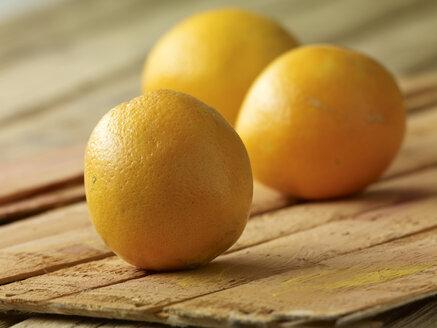 Three oranges on wood - SRSF000539