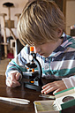 Boy with microscope at home - SARF001358