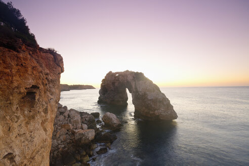 Spain, Mallorca, Es Pontas, stone arch at twilight - MEMF000715