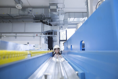 Technician in factory hall - SGF001343