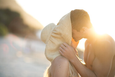 Young couple kissing on the beach - ZEF004630