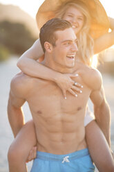 Carefree young couple on the beach - ZEF004632