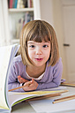 Portrait of little girl with coloured pencils - LVF002880
