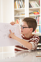 Boy showing his drawing - LVF002882
