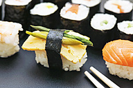 Variety of sushi with green asparagus on plate - JTF000640