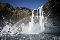 Iceland, Skogafoss Waterfall in winter, rainbow - STCF000070