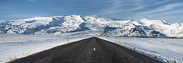 Iceland, Vatnajokull National Park, empty road in winter - STCF000085