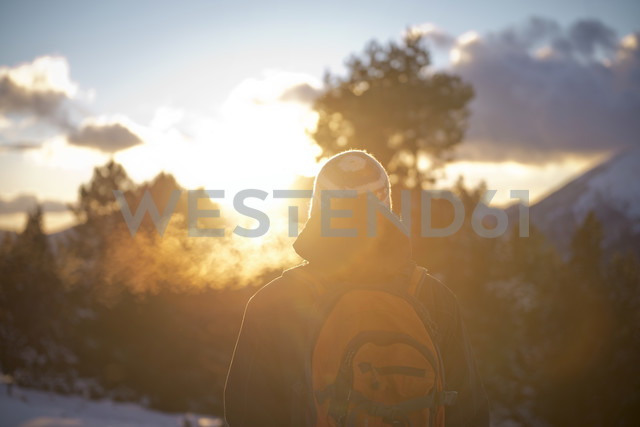 Spain, Cadi-Moixero Natural Park, man in the mountains at sunset - GEMF000058
