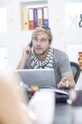 Creative office man talking on telephone - ZEF002976