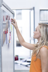 Creative office woman at a whiteboard - ZEF003065