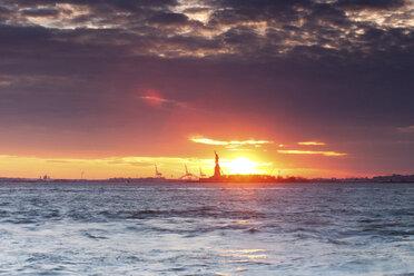 USA, New York, New York City, Manhattan, Statue of Liberty at sunset - FPF000037