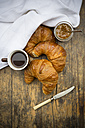 Croissants, fig jam, knife and cup of black coffee - LVF002900