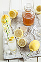Homemade lemonade with bottle of syrup and lemons - SBDF001694