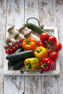 Different vegetables on wood tray - CSF024596
