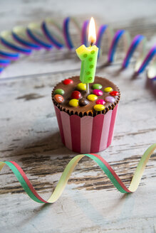 Birthday muffin with chocolate buttons and lighted candle - SARF001406