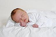 Baby, 4 weeks old, girl sleeps relaxed - LBF001068