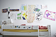 Children's drawings on wall over bunk bed - RH000584