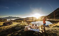 Austria, Salzburg State, Altenmarkt-Zauchensee, alpine pasture, breakfast at sunrise - HHF005109