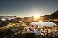 Austria, Salzburg State, Altenmarkt-Zauchensee, alpine pasture, breakfast at sunrise - HHF005124
