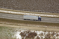Southern Germany, aerial view of truck on country road - KDF000700