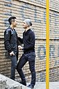 China, Hong Kong, gay couple at house wall - JUBF000007