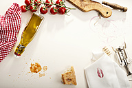 Italian Food, Olive oil bottle, baguette, napkin with lipstick, corkscrew and tomatoes - CSTF000893