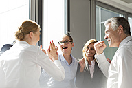 Laughing business people celebrating success - WESTF020919