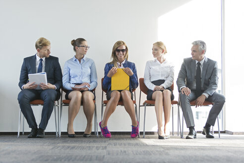 People sitting in a row, waiting for job interview - WESTF020943