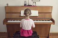 Little girl playing piano at home - OPF000047