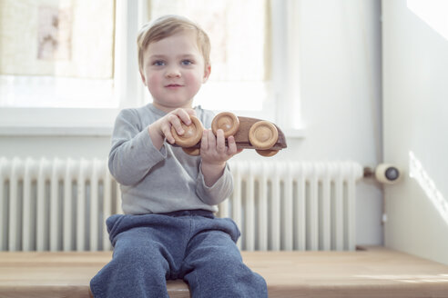 Little boy playing with wooden toy at home - OPF000042