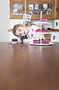Little girl sitting at dining table - OPF000045