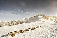 Austria, Salzburg State, Region Hochkoenig ski area in winter, wooden benches - DISF001410