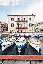 Italy, Veneto, Bardolino, Town hall and moored fishing boats - GSF001001