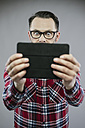 Man with eyes wide open looking excited at digital tablet - IPF000201