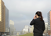 Germany, Berlin, businesswoman on smartphone - BFRF000964
