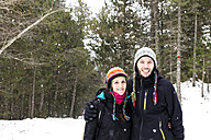 Smiling couple in forest in winter - GEMF000074